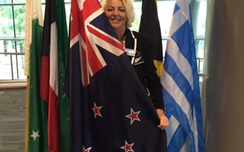 Draped in the New Zealand flag at Million Dollar Round Table Vancouver 2016.